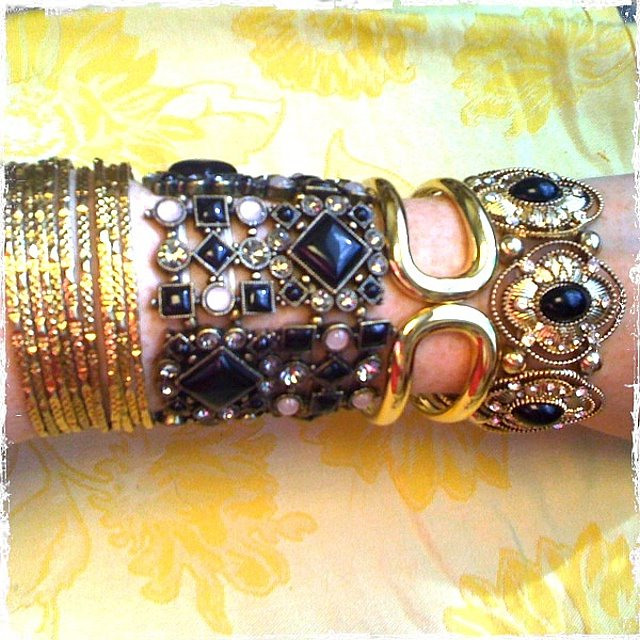Gold studded bangles from Forever 21; black and gold mixed geometric shapes bracelet from Charming Charlie; gold link bracelet from BaubleBar; gold and black stone bracelet from Forever 21.