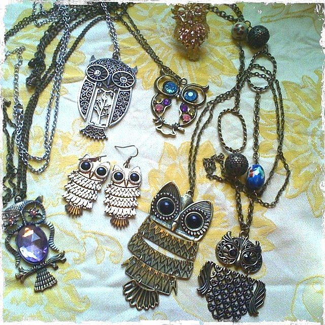 Purple jeweled owl necklace, vintage; gold and black owl earrings from Forever 21 in NYC; silver filigree owl necklace from Maurice's; multi-colored jewel owl necklace, vintage; peach and gold owl ring from Charming Charlie; large antiqued gold owl necklace, vintage; smaller antiqued gold owl neclace from Maurice's.
